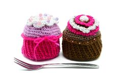 Two crocheted muffins on white isolated background. Royalty Free Stock Photo