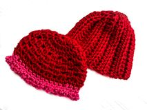 Two Crocheted Red Hats Royalty Free Stock Photography