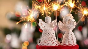 Two crocheted xmas angels with lots of sparklers stock video