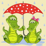 Two Crocodiles with umbrella Royalty Free Stock Photography