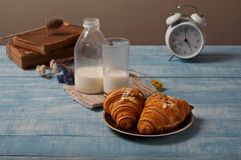 Two croissant in almonds on a plate with milk Royalty Free Stock Photo