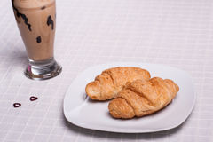 Two croissant and one coffee at breakfast Stock Image
