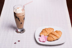 Two croissant and one coffee at breakfast Royalty Free Stock Image