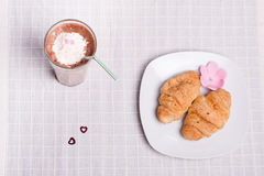 Two croissant and one coffee at breakfast Royalty Free Stock Photography