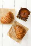 Two croissant over wooden table Stock Photography