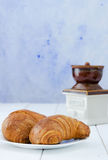 Two croissant on white plate Royalty Free Stock Image
