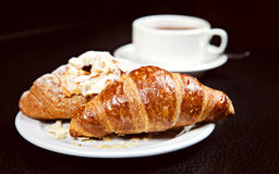 Two croissants and cup of coffee Royalty Free Stock Image