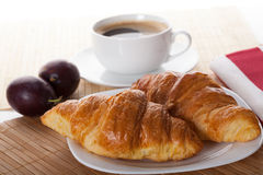 Two croissants and cup of coffee Royalty Free Stock Photography