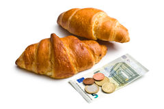 Two croissants and euro currency Stock Photos