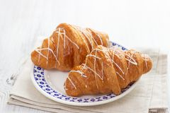 Two croissants on a plate royalty free stock photos