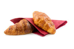 Two croissants on red napkin Royalty Free Stock Photos