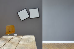 Two crooked frames in empty vintage loft. 
