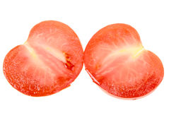 Two cross of a ripe red tomato Royalty Free Stock Photos