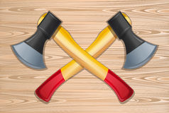 Two crossed axes on a wooden background. Axes. Two crossed axes on a wooden background. Lumberjack axes crossed. Vector illustration Stock Photos