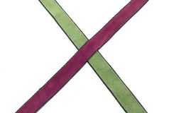 Two crossed bands of rayon Stock Photo