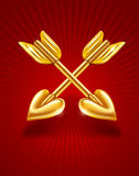 Two crossed gold arrows of cupid with hearts Royalty Free Stock Photography