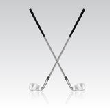 Two crossed golf clubs with reflection Stock Images