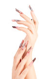 Two crossed hands with beautiful fingernails. Over white background royalty free stock image