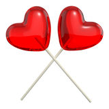 Two crossed heart shaped lollipops Stock Photography