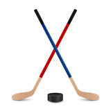 Two crossed hockey sticks and puck. Royalty Free Stock Photos