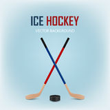Two crossed hockey sticks and puck. Vector EPS10 background. Royalty Free Stock Photography