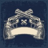Two crossed revolver with bullets and ribbon. Royalty Free Stock Photography