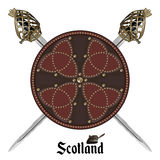 Two crossed Scottish Highland backsword and Scottish battle shield decorated with studs in the Celtic style. Isolated on white, vector illustration Stock Photo