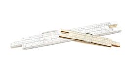 Two crossed vintage slide rule mechanical calculat Stock Photos