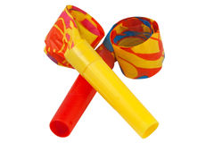 Two crossed whistles. Colored whistles to make noise on carnival parties Royalty Free Stock Photography