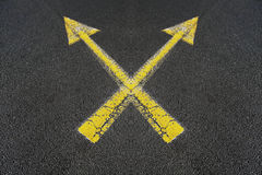 Two crossed yellow arrows Royalty Free Stock Photo
