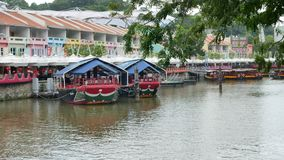 Two cruise boats moored on Clarke Quay in Singapore stock footage