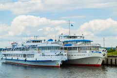 Two cruise passenger ship. Stands on the banks royalty free stock image