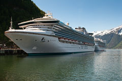 Two Cruise Ships Docked in Skagway Royalty Free Stock Image