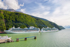 Two Cruise Ships Docked in Skagway, Alaska Stock Image