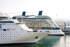 Two Cruise Ships in Harbor. Two cruise ships anchored in a busy port Royalty Free Stock Photos