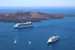 Two cruise ships lying in blue sea in the caldeira of Santorin, Royalty Free Stock Image
