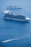 Two cruise ships and other boats Royalty Free Stock Photos