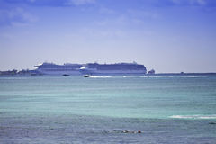 Grand Cayman. Two cruise ships in the port of George Town, Grand Cayman, in the Cayman Islands stock photography