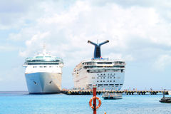 Two Cruise ships at port. Two cruise ships making port in the clear blue waters of the western Caribbean Stock Photos