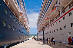 Between two cruise ships in St. Marteen. Walking between two cruise ships in St. Martin Royalty Free Stock Images