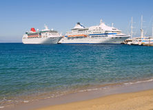 Two cruisers moored in a mediterranean harbor. This harbor is located in Rhodes, Greece Royalty Free Stock Photo