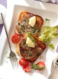Toasts with roasted beef steaks. royalty free stock photos