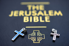 Two cruxifix withe the bible Stock Photography