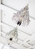 Two crystal chandeliers hanging on white ceiling Royalty Free Stock Photography