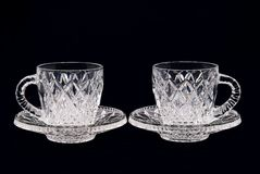 Two crystal cups on a black background. Crystal set for tea drinking on two persons on a black background Royalty Free Stock Photography