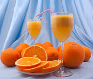 Two crystal glass of fresh orange juice Stock Photos