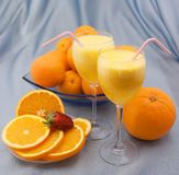 Two crystal glass of squeezed orange juice Royalty Free Stock Images