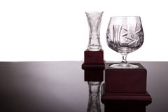 Two crystal trophies with focus on cup trophy at foreground. Two elegant crystal trophies with focus on cup trophy at foreground stock image