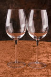 Two crystal wine glasses. A closeup view of two clean, empty, crystal wine glasses Stock Images