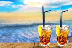 Two Cuba libre exotic tasty cocktail with beautiful sunset back Royalty Free Stock Photography